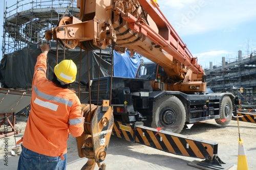 Canvas Print Crane operator conducting safety inspecting on the wire sling which attached wit