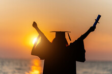 Silhouette Graduates Wear A Black Hat To Stand For Congratulations On Graduation,Silhouette Concept.