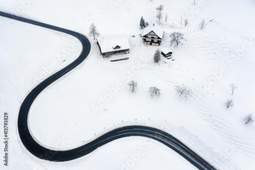 Road winding in the swiss Alps mountains in winter time © Boris Stroujko