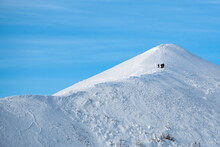 Sihouettes Of A Group Of Skiers From Afar On Vallières Mountains Ridge, Gaspesie, Quebec, Canada