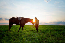 Woman Standing By Horse On Grassy Field Against Sky