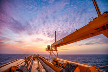 Offshore Drilling During Sunset In The Gulf Of Mexico