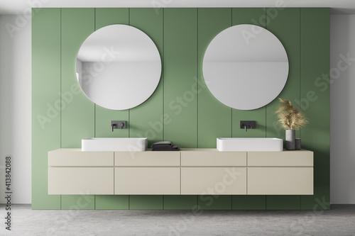 Fototapeta White and green bathroom with two sinks and mirrors, marble floor obraz na płótnie