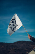A White Flag With A Pirate Skull Drawing.