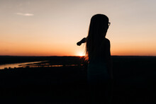 Little Girl Watches Sunset Overlooking Missouri River In Bismarck North Dakota