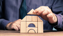 Man Arrange Wood Blocks As A Small House