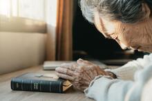 Elderly Asian Women Are Praying For Blessings From God.