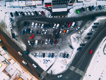 Top Down Aerial View Of Small Parking Place Near Supermarket In Small European City At Winter Sunny Evening