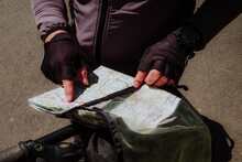 A Cyclist Looking The Map