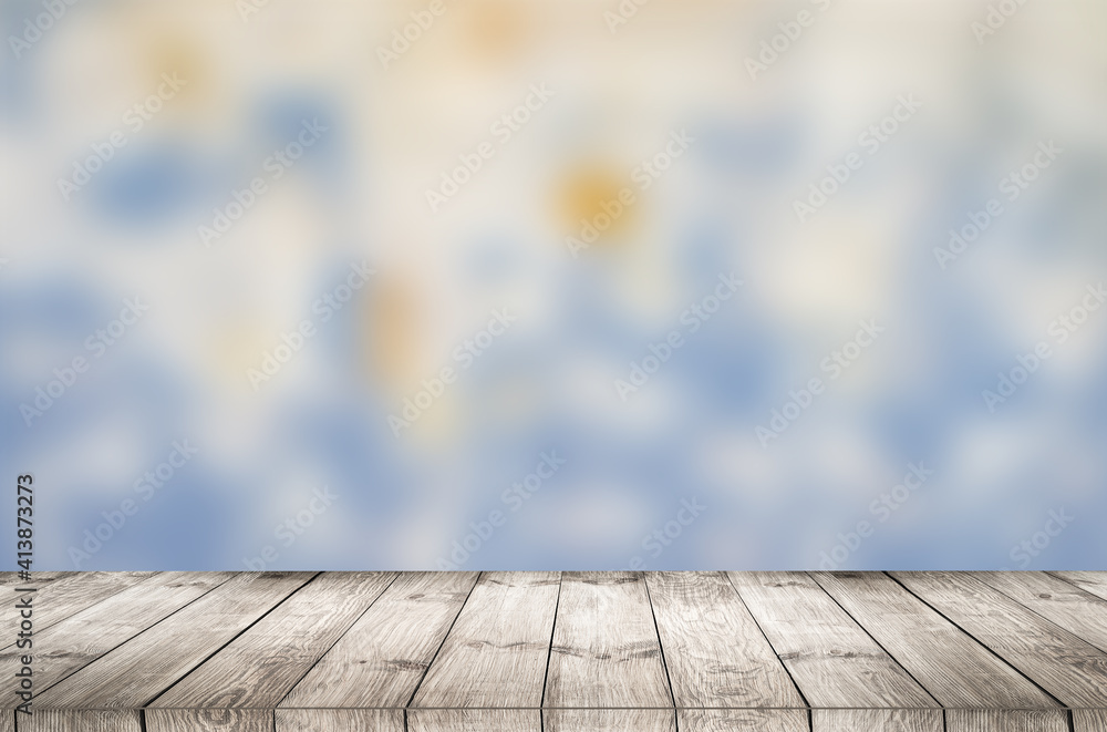 Fototapeta Empty wooden table with garden bokeh for a catering or food background with a country outdoor theme.