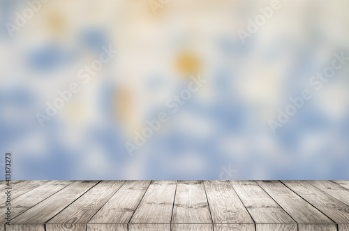 Empty wooden table with garden bokeh for a catering or food background with a country outdoor theme.