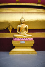 Small Golden Buddha Statue At A Local Temple In Thailand