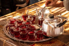 Silver Tray Filled With Glasses Of Hibiscus Tea And Two Teapots