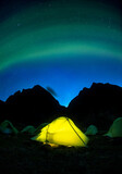 Camping under aurora borealis in the night sky, Torngats Mountains National Park