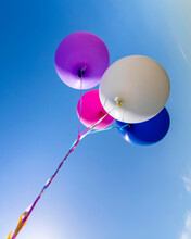 Multicolored Inflatable Balloons Filled With Helium Against The Blue Sky.