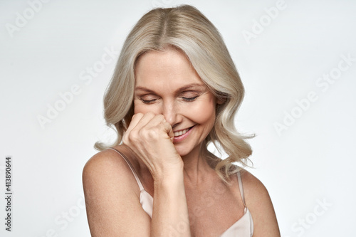 Carta da parati Happy smiling pretty shy 50s middle aged woman laughing, cheerful mature lady touching healthy soft face skin