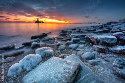 Amazing landscape of frozen beach of baltic Sea in Babie Doly at sunrise. Gdynia, Poland