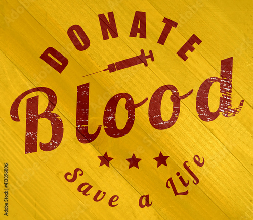 Donate blood sign on wood grain texture #413896806