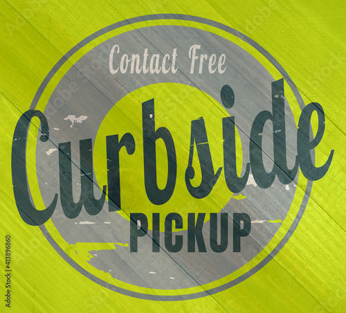 Curbside pick-up sign on wood grain texture #413896860