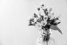 Interior Decoration: Bouquet Of Yellow Wildflowers In A Glass Vase On Gray Wooden Background