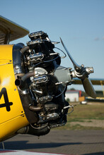 Restored Old Yellow Biplane With One Engine Per Propeller