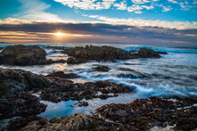 Sunset  And Waves On Rocks At Asilomar State Beach, Monterrey California