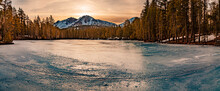 Chaos Crags Across A Frozen Over Reflection Lake In Lassen Volcanic National Park - Shot In Early Morning Light.