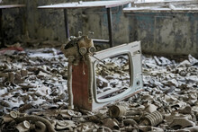Gas Masks On The Floor With An Old Television In An Abandoned Middle School In Pripyat