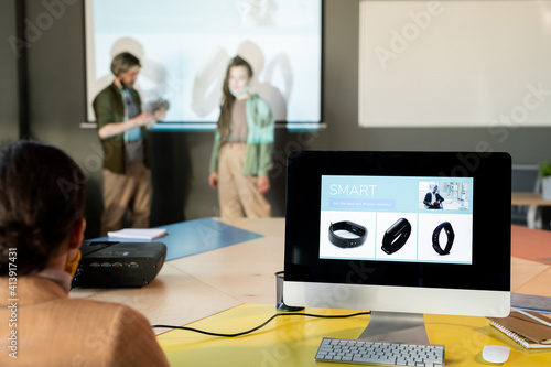 Obraz Pictures of new models of smartwatch on screen of computer standing on table - fototapety do salonu