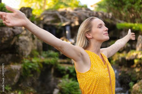 Fototapeta young woman spreading arms outdoor obraz