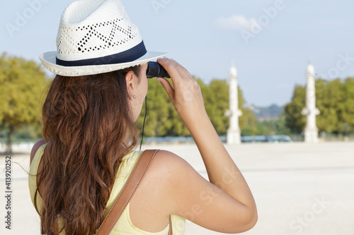 a woman with binoculars outdoors Fototapeta