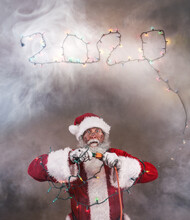 Santa Claus Saying Goodbye To The Year 2020 Getting Shocked By Electric Plug At New Years Eve