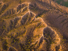Aerial View Of Pai Canyon Mountain Ridges With A Small Road Driving Along, Near The Village Of Pai, Mae Hong Son, Thailand.