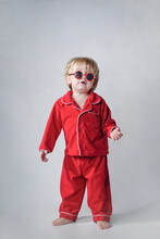 Cute Toddler Wearing Red Pajamas And Red Sunglasses