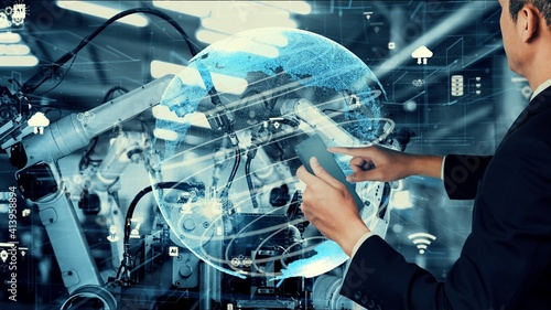 Fototapeta Smart industry robot arms modernization for digital factory technology . Concept of automation manufacturing process of Industry 4.0 or 4th industrial revolution and IOT software control operation . obraz