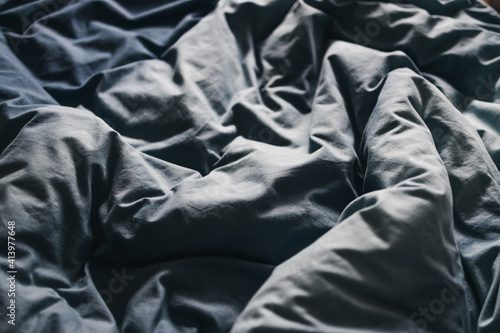Obraz na plátně sleep or couples life, messy queen size bed with blue quilt cover and sheets loo