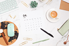 Desktop With Calendar For April And Office Supplies. Home Office, Social Media Blog, Schedule