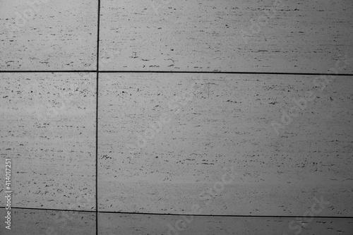 betonowa nowoczesna ściana pokryta szarymi betonowymi płytkami w stylu modern lub loft - fototapety na wymiar
