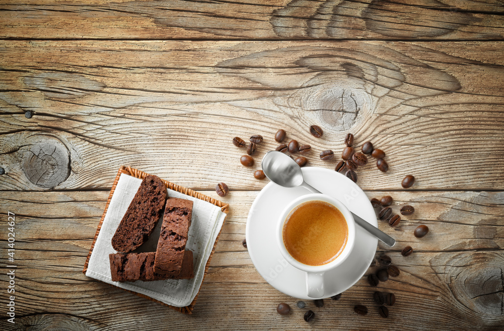 Fototapeta Espresso cup, biscuits and coffee beans on wooden background, top view, space for text.