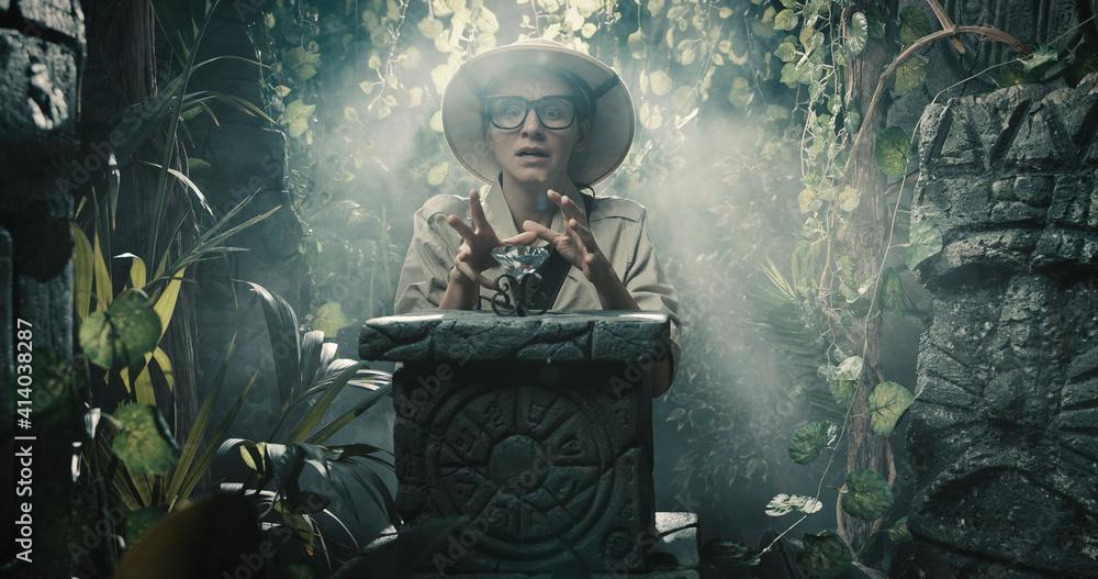 Fototapeta Explorer finding a precious treasure in the jungle