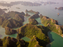 Aerial View Of Scattered Small Islands Archipelagos Near The Dark And Bright Caves In Haiphong, Vietnam.