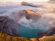 Aerial View Of Ijen Mountain Range With Its Crater Kawah Ljen, Known For Its Blue Flames During A Cloudy Day, East Java, Indonesia.