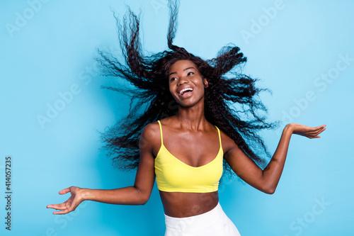 Fotografie, Obraz Portrait of pretty cheerful wavy-haired girl having fun enjoying wind blowing ha
