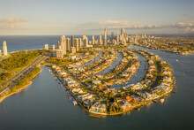 Aerial View Of Macintosh Island With Residential District Along Nerang River With A City Skyline In Background, Queensland, Australia.