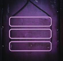 Three Blank Neon Signs Hang On Black Cable, Purple Leather Background