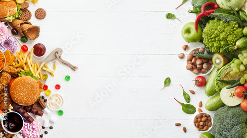 Fast and healthy food compared on white background. Unhealthy set of burgers, sauces, french fries in comparison with set of vegetables, fruits, organic green avocado, cabbage, nuts, citruses.