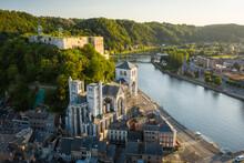 Aerial View Of Notre Dame Et Saint Domitien Church Along Meuse River In Huy, Liège, Belgium.