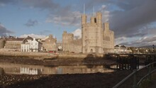 West View Of Caernarfon Castle And Bridge At Evening. Wales