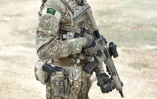 Soldiers With Machine Gun And Flag Of Saudi Arabia On Military Uniform. Collage.