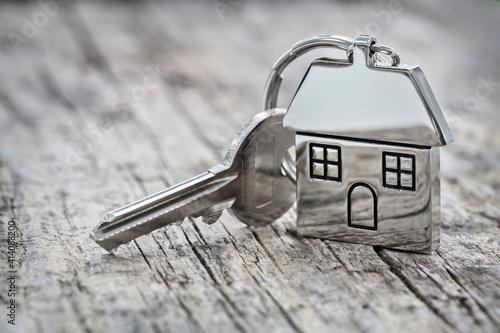 Fototapeta House key on a house shaped keychain background obraz